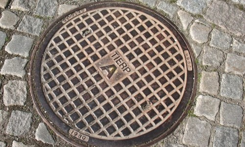 Stepping On A Manhole Cover